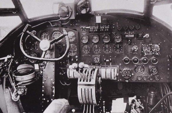 The flying controls. Throttle levers in the middle, control column on the left.