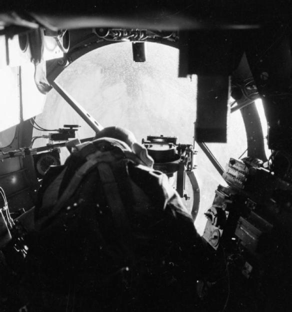 A Lancaster Bomb Aimer looks down to the target.